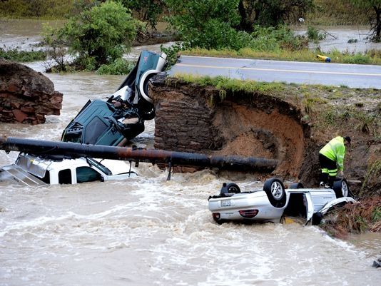 A bridge collapsed after flash flooding in the Front Range of Colorado (Broomfield, CO, Sept. 12, 2013) Photo: Cliff Grassmick, AP