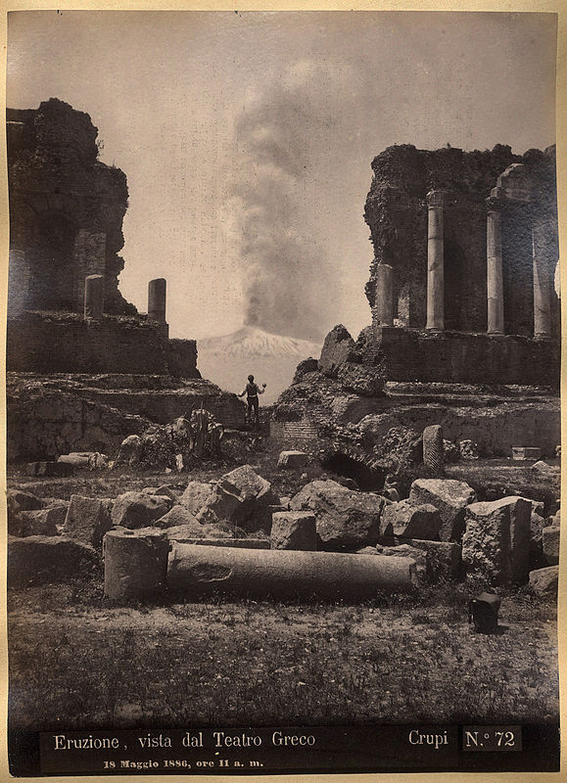 "Caption: ""Eruzione, vista dal Teatro Greco, 18 Maggio 1886, ore 11 a.m."" (Eruption, seen from the Greek Theater, May 18, 1886, 11 a.m.), photograph taken by Giovanni Crupi in Taormina, Sicily during the Etna eruption of 1886."