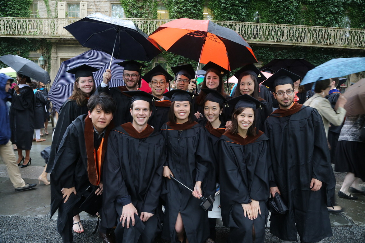 Several 2015 M.Arch graduates gather in the rain for a group shot ( Photo by John Jameson, Office of Communications).